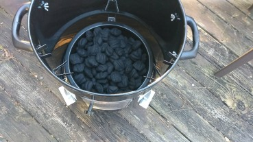 The charcoal inside the smoker.