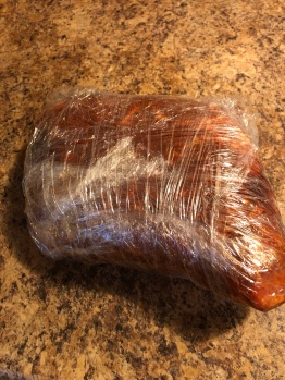 Seasoned Pork Shoulder Wrapped In Plastic Wrap
